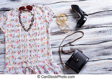 White top with colorful pattern. Woman's top, shoes and...
