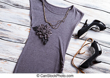 Gray flower applique top. Black heel shoes and necklace....
