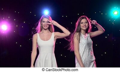 Girls are dancing making the similar gestures. Slow motion -...