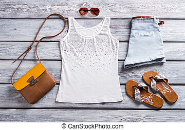 White tank top and sunglasses. Brown flip flops and purse....