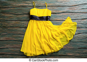 Casual yellow dress with straps. Black insert on yellow...