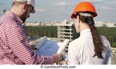 Architect and engineer looking on project - Architect and...