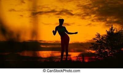 carefree woman dancing in the sunset vacation vitality...