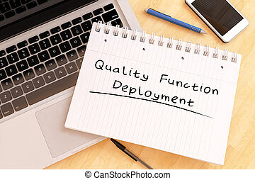 Quality Function Deployment - handwritten text in a notebook...