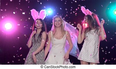 Girls dancing at bachelorette party making blowing kisses....