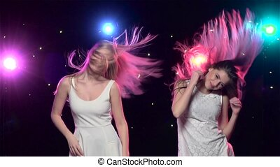 Girls are dancing making the similar gestures heads. Slow...