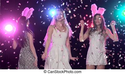 Girls at bachelorette party dancing and kiss bride. Slow...