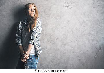 Daydreaming girl against wall - Casually dressed,...