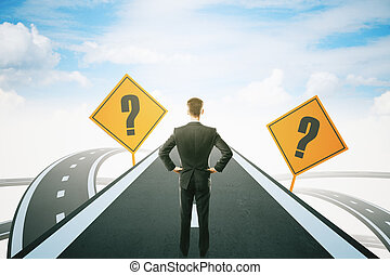 Businessman on highway road - Success concept with question...