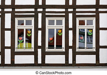 Windows of half-timber house in Hameln, Germany. - Three...