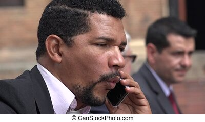 Hispanic Or African Business Man Talking On Cell