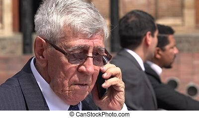 Confused Or Worried Ceo Or Senior Exec Talking On Phone
