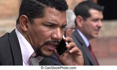 Business Man Speaking On Cell Phone