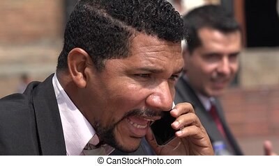 Excited Business Man Talking On Cell Phone Receiving Good...