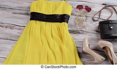 Yellow dress, purse and shoes.