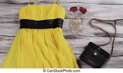 Yellow dress and black purse. Lady's bracelet set and...