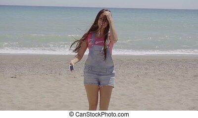 Happy beautiful woman walking near beach - Single happy...