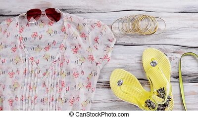 V-neck blouse and flip flops. Woman's yellow footwear and...