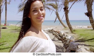Cute cheerful woman near tropical beach - Single cute...