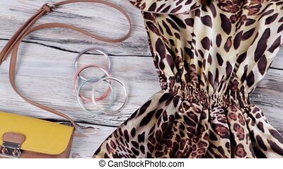 Leopard dress with bicolor purse. Sandals and colorful...
