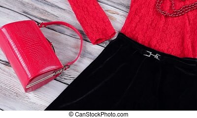 Black skirt and red bag. Top, skirt and heel shoes. Glossy...