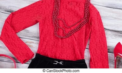 Red top with black skirt. Bead necklace and evening top. New...