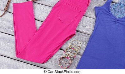 Blue top and pink pants. Bracelets and wedge sandals. Girl's...