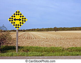 Caution Sign - A photo of a caution sign in front of a field...