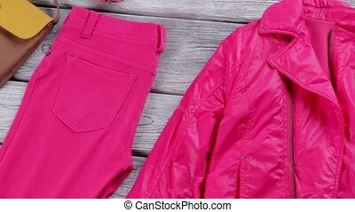 Bright pink jacket and pants. Trousers and colorful...