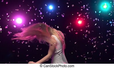 Carefree girl are dancing and whirling against lights Slow...