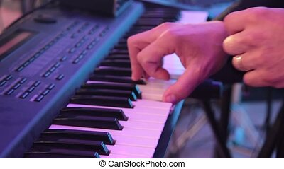 Man is playing the piano. Close up