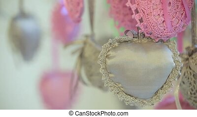 Decoration hearts are hanging from tree Dynamic change of...