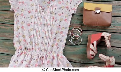 White blouse and wedge sandals. Bicolor brown purse and...