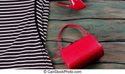 Red heels and sunglasses. Bright purse and heel shoes....