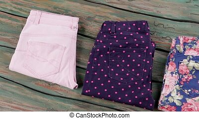 Blue trousers with flower print. Colorful folded pants....