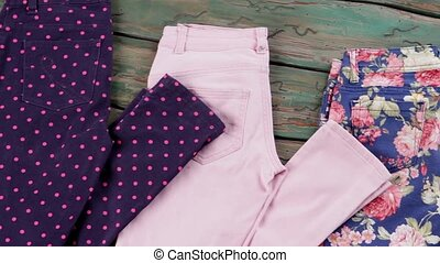 Dark trousers with dotted print. Colorful pink folded pants....