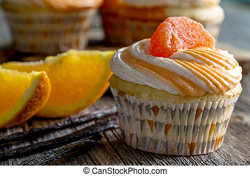 Orange Vanilla Bean Swirled Cupcakes - Close up of orange...