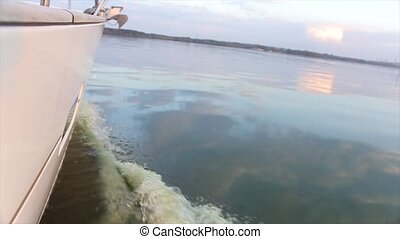 Water waves from motor boats. Close up - Motor boat white...