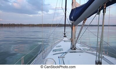 Walking on water. View from the stem of yacht. Close up -...