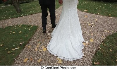 Bride and groom are on the road Slow motion - Bride and...