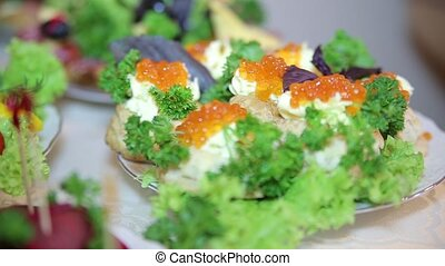 Pancakes with caviar and butter. Fresh vegetables. Close up...