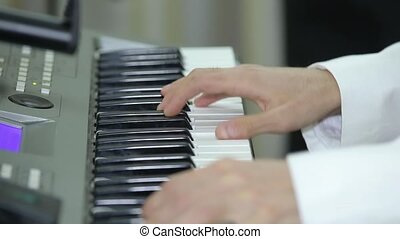 Musician is playing the piano. Close up