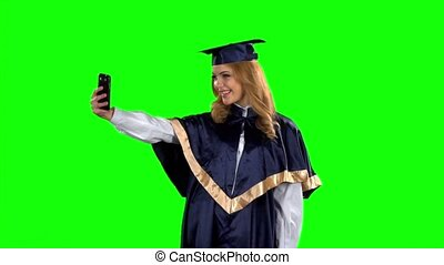 Graduate taking picture with smartphone. Green screen. Slow...