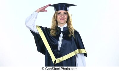 Graduate throws his cap in the air. Celebrating graduation. White. Slow motion