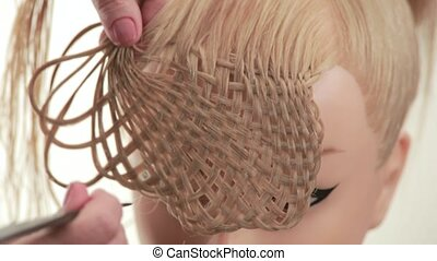 Formation of bulk weaving of the strands. Weave hairstyles....