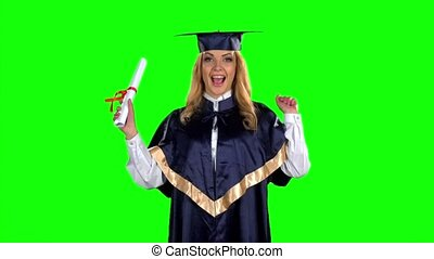 Woman graduate in gown with diploma. Green screen. Slow...