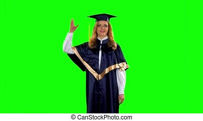 Graduate throws his cap in the air. Green screen. Slow...