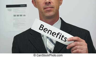 Businessman Cuts Benefits Concept - Male office worker or...