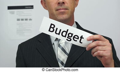 Businessman Cuts Budget Concept - Male office worker or...