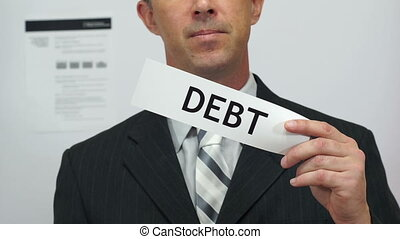 Businessman Cuts Debt Concept - Male office worker or...